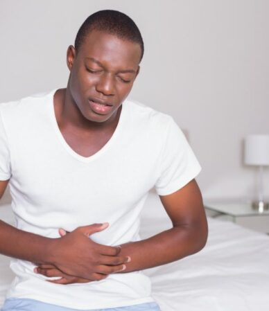 man-holding-his-stomach-in-pain