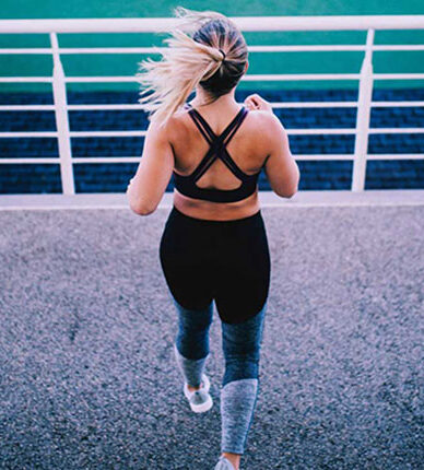 woman-exercising-at-stadiu